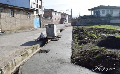 عملیات عمرانی احداث پیاده رو در کوچه شالیزار