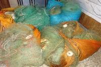 جمع آوری ادوات صید از پشت سد منجیل