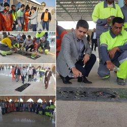 شهردار خرمشهر به همراه پاکبانان در ساعات اولیه سال جدید در گلزار مطهر شهدا حضور یافت