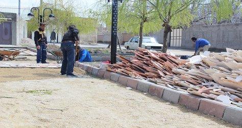 عملیات کف سازی و جدول گذاری بوستان یاس