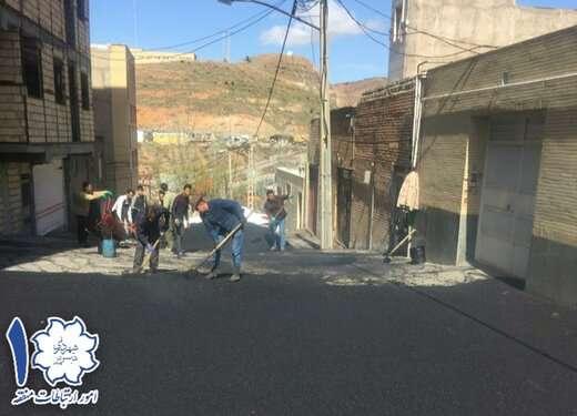 عملیات آسفالت ریزی و اصلاح مسیر در اول کوی شهید بهشتی