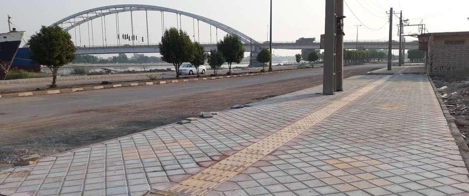 کفپوش گذاری و احداث پیاده رو بلوار ساحلی بایندر جنب پل شهید جهان آراء خرمشهر