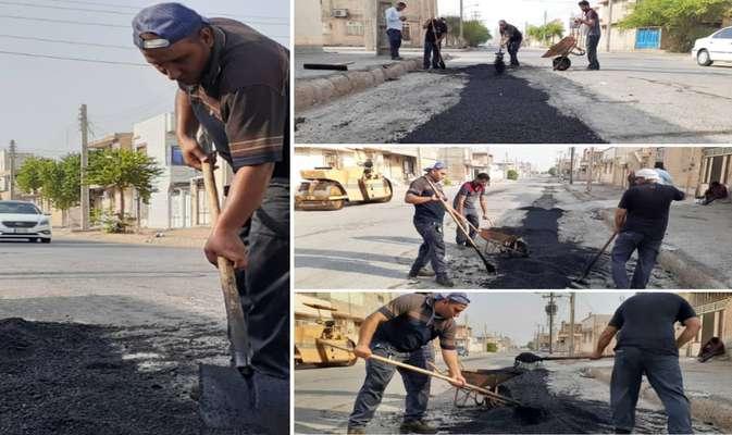 عملیات اجرایی لکه گیری آسفالت معابر کوی طالقانی توسط شهرداری خرمشهر