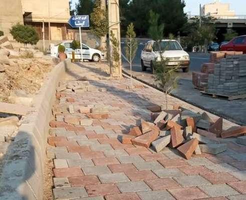 ادامه عملیات پیاده روسازی خیابان قانون ابتدای کوی گیشا
