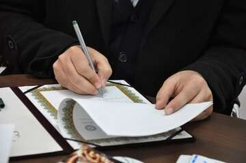 کشتیرانی جمهوری اسلامی و بانک تجارت تفاهمنامه بانکی امضا کردند